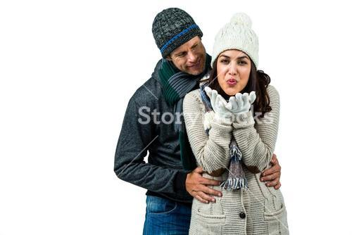 Festive couple in winter clothes