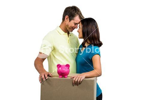 Couple with box standing close to each other