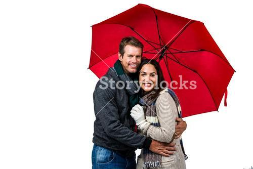 Portrait of happy couple with umbrella