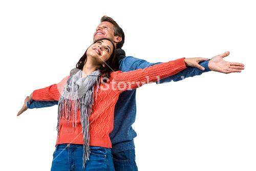 Couple with arms outstretched