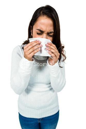 Sneezing woman while standing