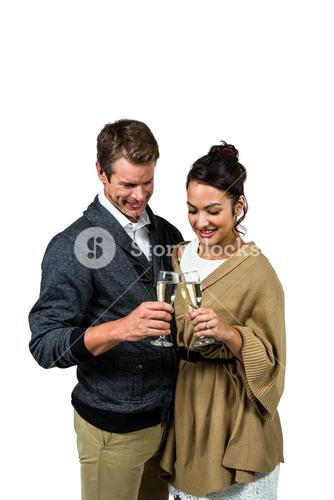 Happy couple holding wine glasses