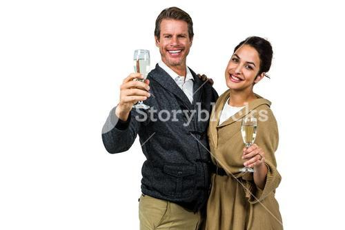 Portrait of dmiling couple holding wine glasses