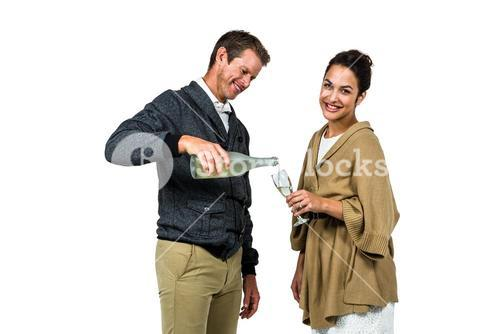 Man pouring wine in glass with woman