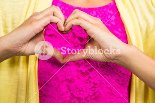 Midsection of woman with heart shape
