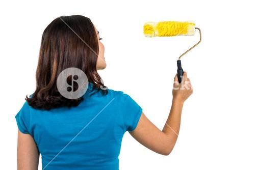Rear view of woman holding paint roller