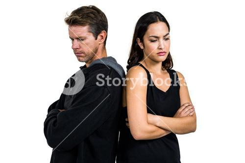 Angry couple standing over white background