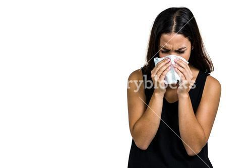Unhappy woman blowing nose