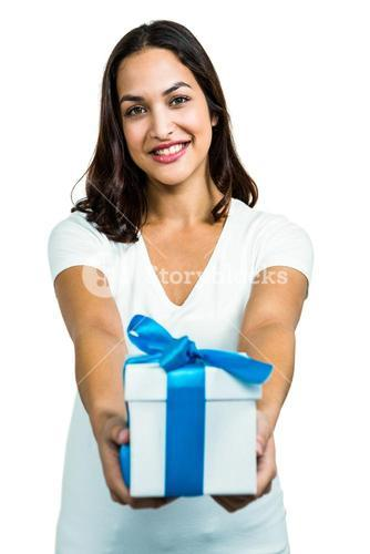Portrait of young woman giving gift box