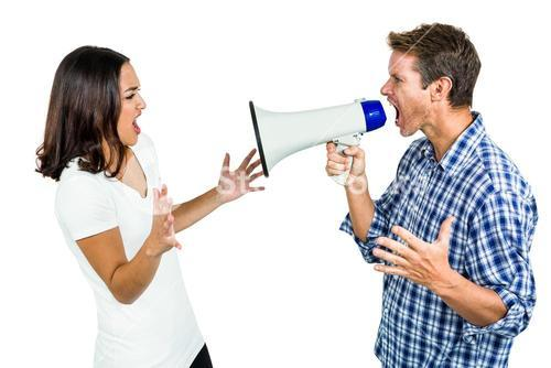 Couple shouting with man holding megaphone