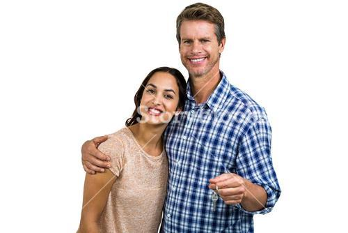 Portrait of cheerful couple with keys