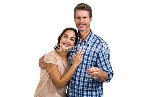 Portrait of cheerful couple holding home keys