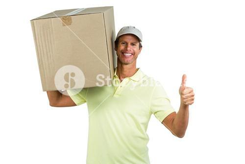 Cheerful delivery man with box showing thumbs up