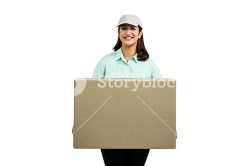 Portrait of cheerful delivery woman with box