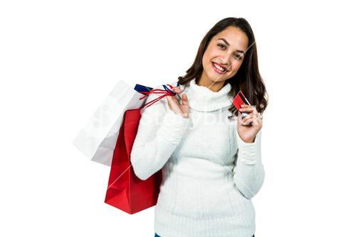Portrait of happy woman with shopping bags and payment card