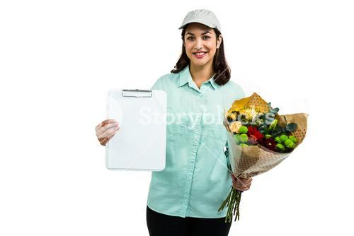 Portrait of cheerful delivery woman with flower bouquet