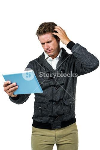Confused man with digital tablet