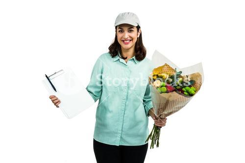 Portrait of happy delivery woman with flower bouquet