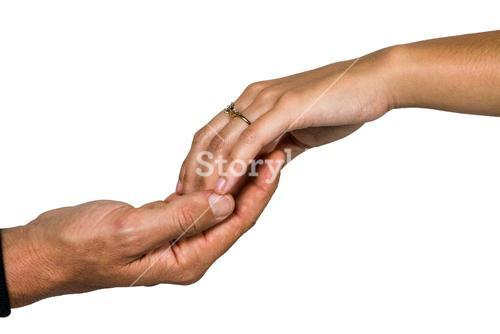 Cropped hand of couple holding hands