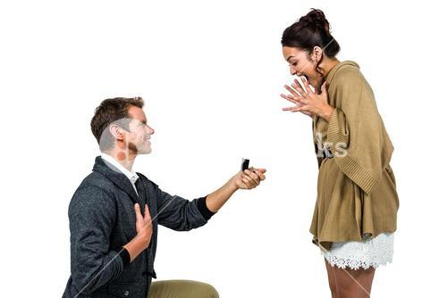 Happy man offering engagement ring to partner