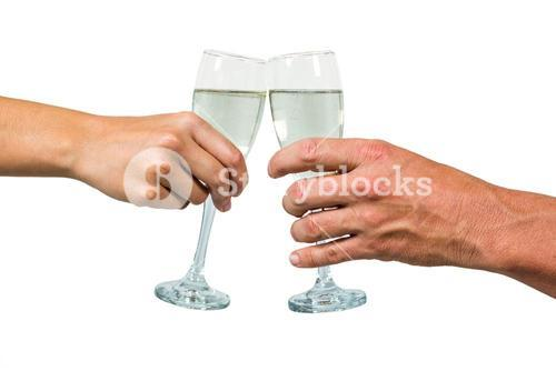 Cropped hand of couple holding champagne flute