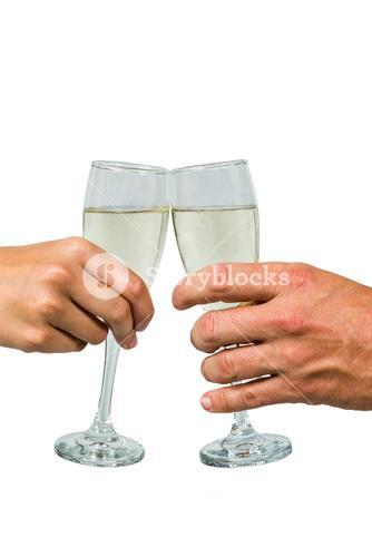Cropped hand of couple toasting champagne flute