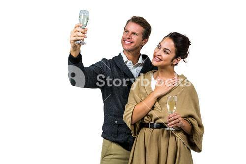 Cheerful couple with champagne flute