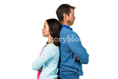 Angry couple standing back to back