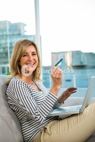 Woman paying on internet with her credit card