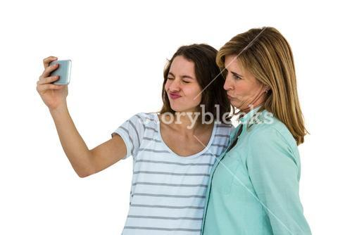 Mother and daughter make a selfie
