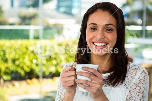 Young girl drink her tea