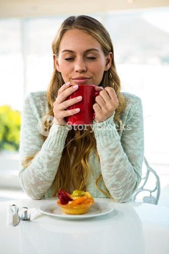 Young girl drink her coffee