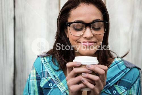 Girl smelling her coffee