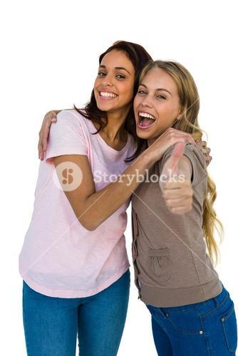 Two girls thumbs up