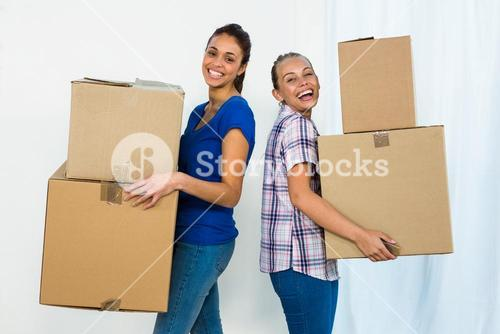 Friends holding boxes