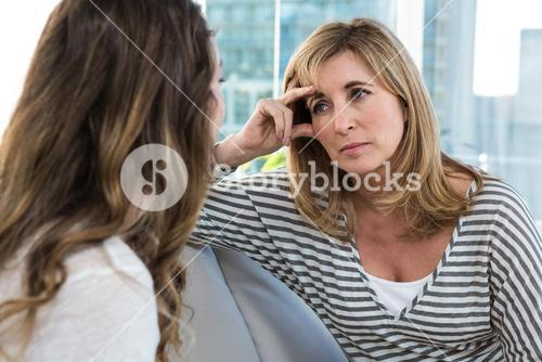 Worried mother talking to daughter