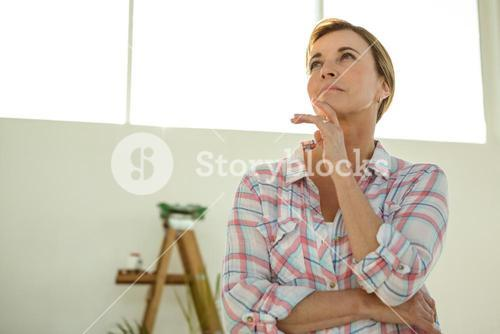 Woman thinking with hand on chin