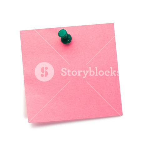 Pink postit with a drawing pin