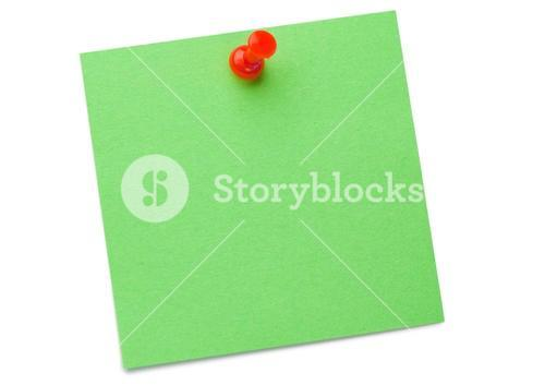 Green postit with a drawing pin