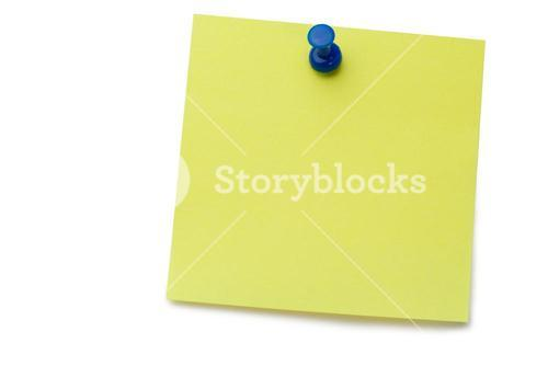 Yellow postit with a drawing pin