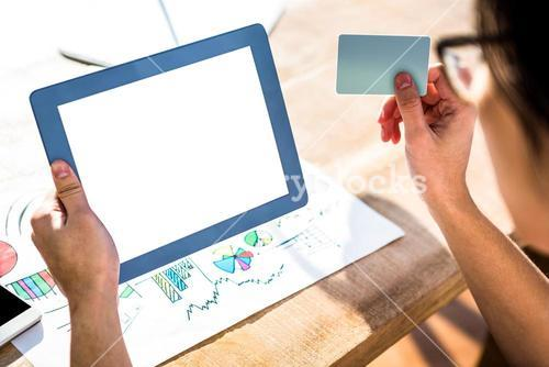 Cropped image of hipster businessman using tablet and credit card