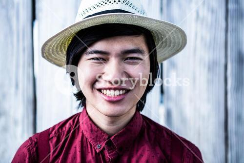 Smiling hipster with a straw hat