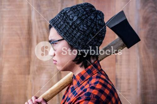 Side view of hipster holding a axe