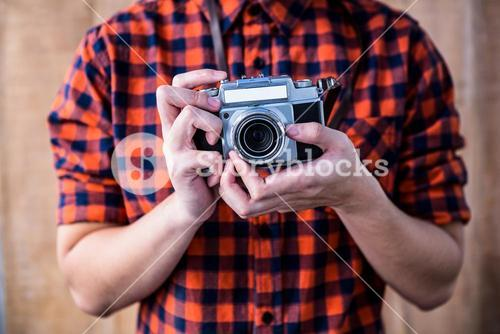 Hipster holding an old camera