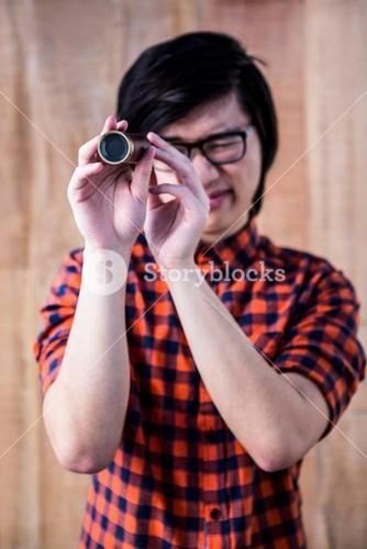 Hipster looking through a telescope