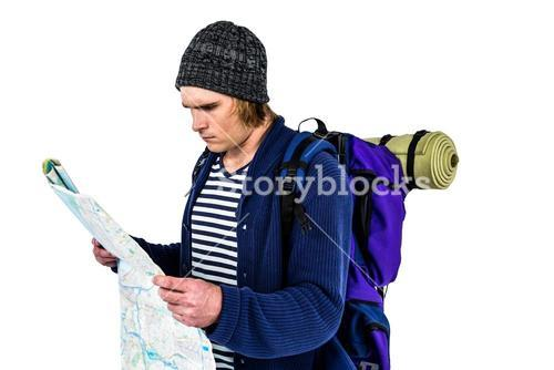 Backpacker looking a map
