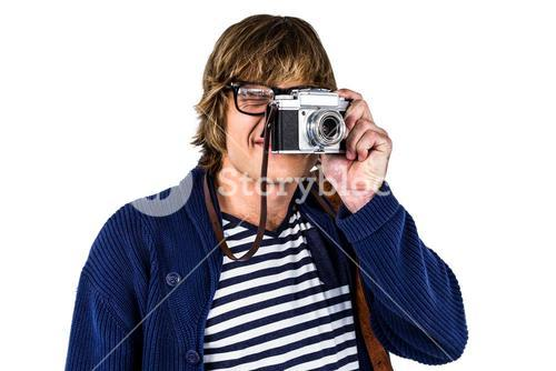 Hipster taking pictures with an old camera