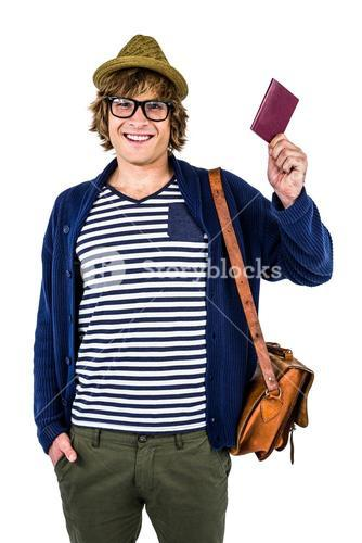 Smiling hipster holding a leather wallet