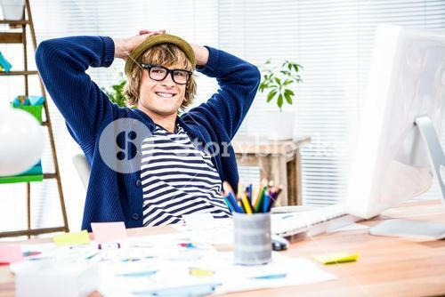 Smiling hipster businessman takes a break