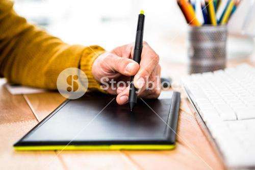 Close up view of businessman using tablet graphic